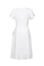 Đầm trắng tùng váy xòe đắp chéo tay đính hoa