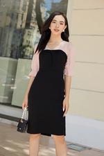 Đầm ôm đen phối hồng tay lỡ cổ tim